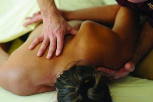 Deep tissue massage beneath the shoulder blade