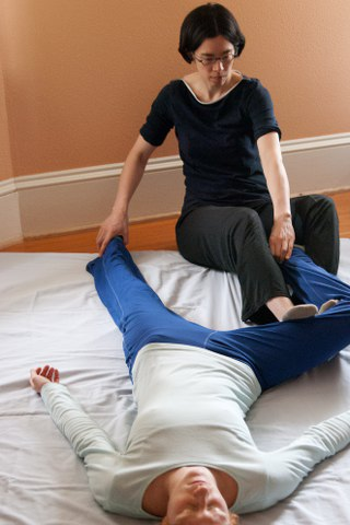 Receive deep stretches and pressure with Thai massage
